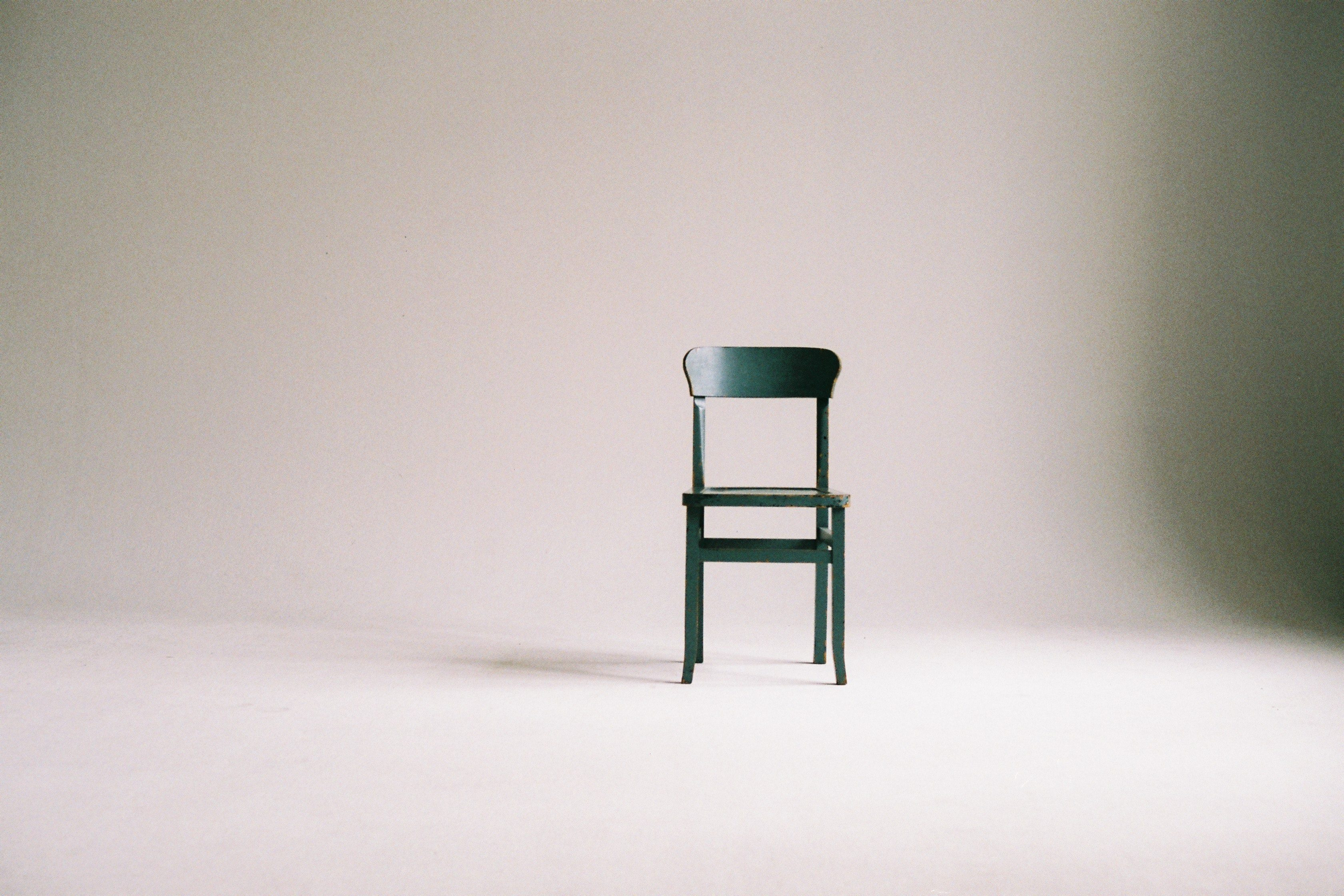 Green Wooden Chair in white empty room