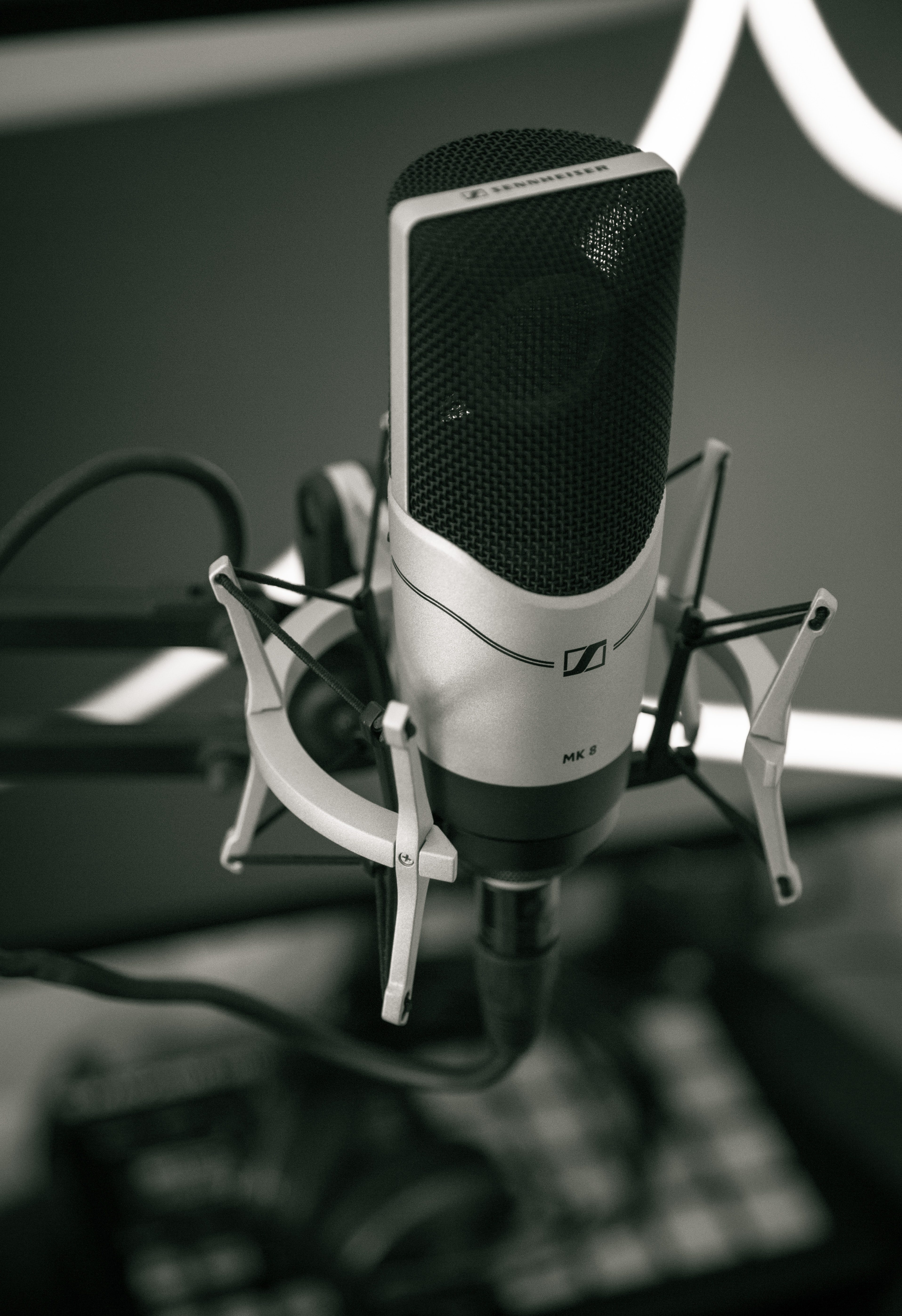 Selective Focus Photography of greyscale Condenser Microphone