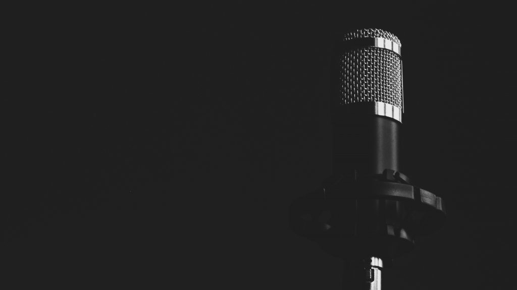 Grayscale photograph of Condenser Microphone in front of black background