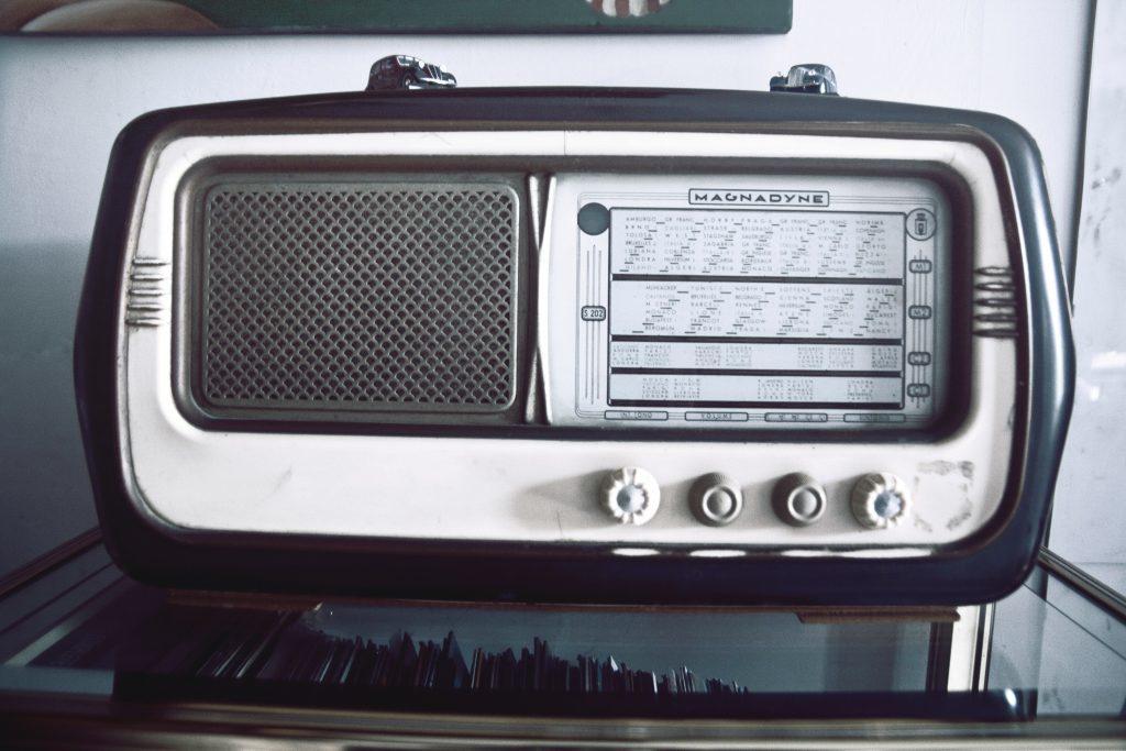 medium close up photograph in Greyscale, of grey and Black Magnadyne radio Transistor